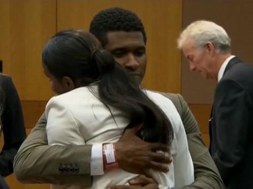 Usher Tameka Raymond hug in court