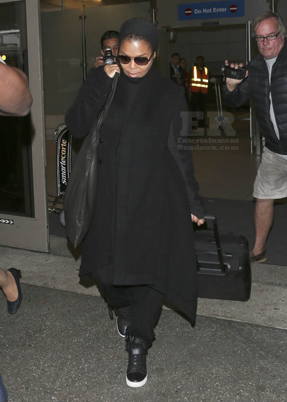 Janet Jackson Pulls Her Luggage Along As She Arrives At LAX