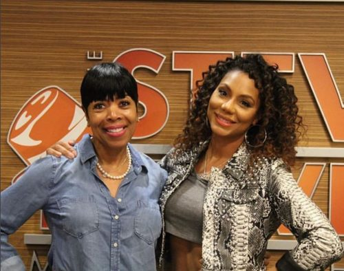 Tamar poses with Steve's cohost, Shirley Strawberry.